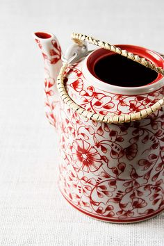 teapot with red flowers