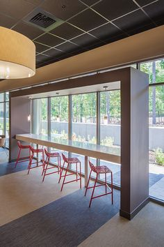 CHILEWICH PLYNYL®  TILE FLOORING IN TEA AND CHARCOAL BAMBOO AND DARK BROWN AND WALNUT IKAT, AND  PLYNYL®  WALL-TO-WALL FLOORING IN TOPAZ FROST AT SOUTHWEST POWER POOL IN LITTLE ROCK, AK, USA | PHOTOS: KEN WEST PHOTOGRAPHY