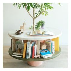 I have always loved these wooden spool coffee tables. What I want to know is... where do you find the wooden spool?!? I love the way this combines my two favorite things. Nature and books <3