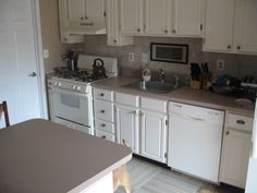 Excellent Small Kitchen Ideas Displaying White Finish Oak Wood Kitchen Cabinets Which Has Round Brushed Nickel Knob Pull Handle And Eased Edge Brown Granite Countertop As Well As Kitchen Appliances Deals Also Stainless Steel Appliance Package of Cheap Small Kitchen Appliance Packages Deals from Furniture Ideas