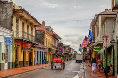 Bourbon Street day scene shot in HDR by Patrick Potter. After a hard cleansing rain in the French Quarter the clouds have moved on and the sun is coming out. People have started to venture out of the Bourbon Street bars where they took shelter. Hang this art print on your wall and bring a New Orleans flair to your home decor.