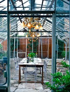 hate the furniture here but love the idea of an outdoor dining space in a green house