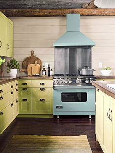 Celadon cabinetry pairs playfully with an aqua enameled range to create casual appeal in this kitchen in a lakeside home: http://www.bhg.com/kitchen/cabinets/styles/kitchen-cabinet-color-choices/?socsrc=bhgpin022314freshtakeoncabinstyle&page=14