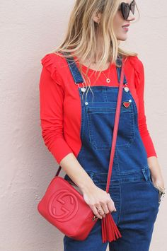 denim dungarees, red top, red gucci disco bag, heart pin