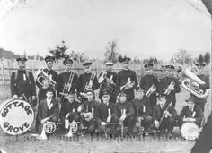 The Cottage Grove Band members pose with their horns, drums and clarinets in outdoor setting. date unknown. Source: LCHM - GN3412