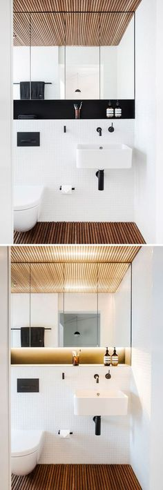 This modern bathroom features a timber slat floor and ceiling to introduces texture and tactility, while the white tiles and large mirror help to brighten the space.