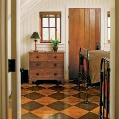 A checkerboard floor is inherently playful. It's also timeless: During the colonial era, a decorative painted floor was a major upgrade over bare wood. For an updated tweak on the tradition, trade painted squares for stained ones in a dark espresso hue Staining Wood Floors, Painted Wood Floors, Hardwood Floors, Plywood Floors, Laminate Flooring, Checkerboard Floor, Checkered Floors, Floor Stain, Floor Patterns