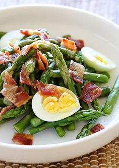 1 hard boiled egg, sliced 1 2/3 c chopped asparagus 2 slices cooked and crumbled bacon 1/2 t Dijon mustard 1 t olive oil 1 t red wine vinegar pinch salt and pepper  Boil asparagus 2 to 3 minutes, until tender yet firm. Drain. Set aside.  In a small bowl mix the Dijon, oil, vinegar and a pinch of salt and pepper.  Arrange the asparagus on a plate, top with egg and bacon and drizzle with the vinaigrette. Enjoy!