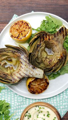 Artichoke 101 Artichoke 101 From simply boiling the veggie to grilling it, here is your guide to preparing the perfect artichoke.<br> From simply boiling the veggie to grilling it, here is your guide to preparing the perfect artichoke. Vegetable Dishes, Vegetable Recipes, Veggie Meals, Veggie Food, Vegan Recipes, Cooking Recipes, Cooking Games, Cooking Corn, Cooking Pumpkin