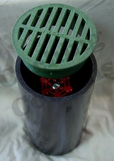 This is a fake drain. You bury it nearly flush with the ground then set the bottle in it and put the lid on it.  It is very tough to tell that its