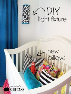 IKEA bag holder to DIY light fixture! http://sisterssuitcaseblog.com/2012/08/ikea-bag-holder-to-diy-light-fixture.html