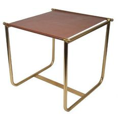 <p>The Equestrian Side Table in Brown from Nate Berkus is a unique piece for your home. The accent table has a metal frame with curtain-rod style dowels across which is strung the fabric tabletop. The side table works well beside a couch or between two chairs and is a great display space for your magazines.</p> <ul> <li> <p><strong>Frame Material:</strong> Metal</p> </li> <li> <p><strong>Tabletop Material:</strong> Leather</p> </li> <li> <p><strong>Surface Material:</strong> M...