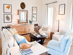 White & Textured Living Room with weathered console, patterned trim on curtains, white sofa, oversized sisal rug and botanical prints - Elizabeth Newman Interior Design (St. Kitts Portfolio)