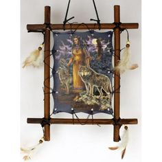 This picture frame is made from real wood, with a canvas material featuring images of an Indian girl with several wolves by her side. Complete with feathers and
