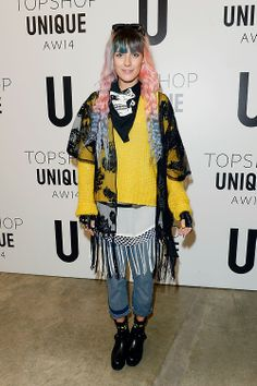 Model Chloe Norgaard pulls of our bright yellow knit and the Boutique jeans like no other.