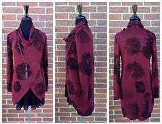 Beautiful Cranberry! Love the over sized roses black. Wear it down and open as a cardigan or buttoned up. Longer in the back than front. 65% polyester/35% viscose.  Cross over top: S-L $56