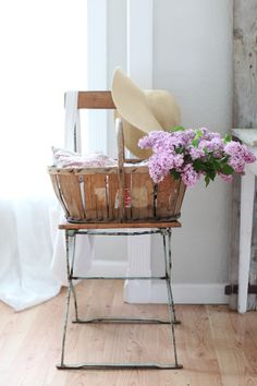 'lilacs and chair with sun hat' -  an entire mood has been created -with this still life!