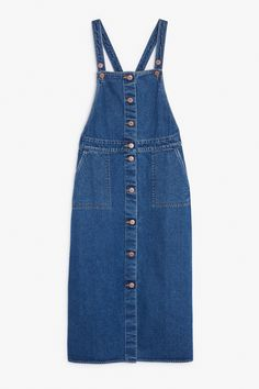 This bewitchingly cute dungaree dress is a truly multi-seasonal piece of denim. Styled with a polo? Amazing. Flirty summer top? Fab. Possibilities are endless. Note the roomy cargo pockets and bounty of copper buttons.  colour: mid blue In a size small the waist width is 78 cm and the skirt length is 77 cm. The model is 173 cm and is wearing a size small.