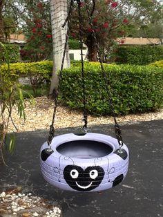 Purple Ladybug Tire Swing from www.cooltireswings.com