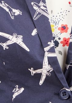 Take flight looking fashionable in this navy blazer, for when you land, a momentous meeting awaits! From hard-to-find British brand Emily and Fin, this cotton layer keeps you looking and feeling cool with padded shoulders, pockets, and an ivory airplane print that parades your personality.