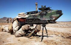 A USMC Marine deploys the new Heckler & Koch M27 IAR