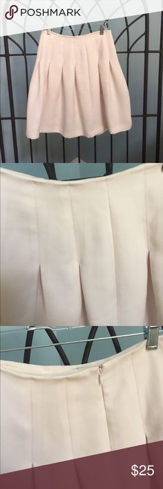 Pink Club Monaco Skirt Beautiful pale pink fluted skirt. Yummy color, perfect for spring, small stain  but have not tried to get out. Bought two years ago, worn a handful of times. Offers welcome! Club Monaco Skirts A-Line or Full