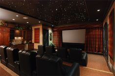 Home Theatre - love the black ceiling with twinkle lights, the curtains lining the scree . At Home Movie Theater, Home Theater Rooms, Home Theater Seating, Home Theater Design, Theatre, Basement Movie Room, Star Lights On Ceiling, Home Theater Furniture, Black Ceiling