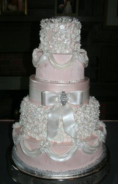 Pink wedding cake with ribbon and flower details.  Love.  You can use your own colors.  To me it is more important how the cake tastes rather than how it looks~