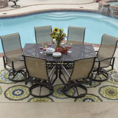 7 pc. Dining Set. Cast Aluminum frame with heavy-duty, polyester tan sling with PVC coating. 6 ea. Swivel Rockers