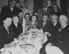 1946. John F. Kennedy having dinner with his family, friends, and campaign workers. Seated left to right: Francis X. Morrissey, Mary Josephine Fitzgerald, Eunice Kennedy (center), Jack, Honey Fitz, and Joseph F. Timilty. Lem Billings is standing behind Josie Fitzgerald. Kenny O'Donnell and Helen Sullivan (the future Mrs. O'Donnell) are standing behind Jack and Honey Fitz