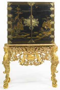A William and Mary parcel-gilt black-japanned cabinet on later giltwood stand, circa 1690. Sotheby's