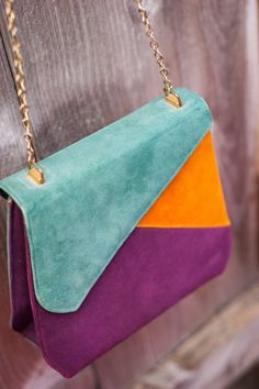 1980's Color Block Purse  I love the off-set fabric/metal chain and funky opening of this truly incredible 80's piece! The rich purple, mustard yellow and turquoise of this purse make this one statement piece that will be an eye-catcher for sure!  https://www.etsy.com/listing/153027015/1980s-color-block-purse?ref=shop_home_active