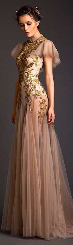10/26/15  This gown embodies tulle and a form fitting bodice, I love the colors and the design overall