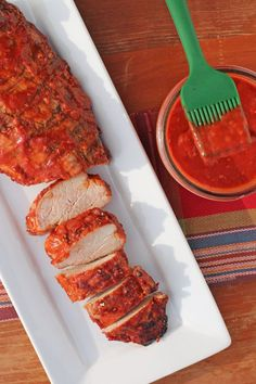 This Raspberry Chipotle BBQ Sauce served here with pork tenderloin is made with fresh raspberries for a sweet, tangy, spicy taste - perfect for grilling! www.emilybites.com