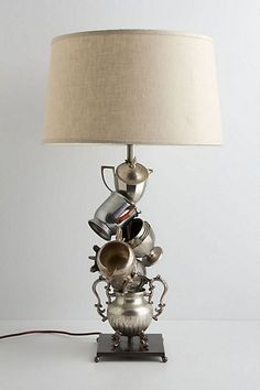 Teacup/Teapot Lamp @ Anthropologie - I've been meaning to do this DIY, but love the metallic offkilt structure much more than what I imagined! Unique Lighting, Home Lighting, Lighting Ideas, Teapot Lamp, Chandelier Lamp, Home And Deco, Lamp Bases, Light Decorations, Lamp Light