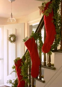 Banister decoration ideas, love the stockings since our fireplace is downstairs!