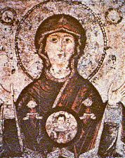 """The """"Sign"""" icon depicts the Infant Lord in a sphere (mandorla) above the chest of the MostHoly Mother of God. Such icons appeared in the 12th century after a miraculous event. During a siege, the Lord commanded a Bishop to circle the city walls with the icon. When an arrow pierced the face of the Holy Virgin, tears trickled and Her face turned towards the city. The enemies were frightened; they started attacking each other and the city was saved. (Oct 27, Nov 27)"""