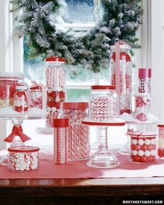 """Candy-Shop Gifts - Red-and-white-striped peppermint candy sticks, jelly beans, jawbreakers, and foil-wrapped chocolates make easy, beautiful Christmas decorations and gifts. Save jelly, pickle, and spaghetti sauce jars to make this craft, or purchase containers at a discount store"""