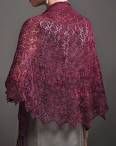 A sumptuous lace and beaded shawl shaped using Elizabeth Zimmermans's Pi formula. The semi-circular shape helps the shawl to sit neatly around the shoulders. The lace pattern is highlighted with beads to catch the light and complement the glowing shade of the Fyberspates Gleem Lace yarn.