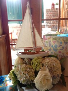 Cute boats swimming in flowers for a nautical baby shower