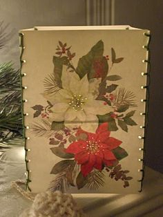 Luminarias made out of old Christmas cards. I could use some of the old cards I have on my Christmas Illustrations board and have any look I want, not just cards I have on hand-any decade, any style. Oh, boy.