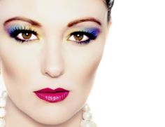 this image is aimed at older women, this wouldnt be suitable for teenagers because they wouldnt wear this sort of make-up, this is how different products have different target audiences. this image is a coloured image focusing on lipstick and eye make-up and the lipstick, it is a very bright image  that would attract younger people, such as 7-11 year lds because they will get the idea that she looks like a princess and they will want to mess on and try this style.