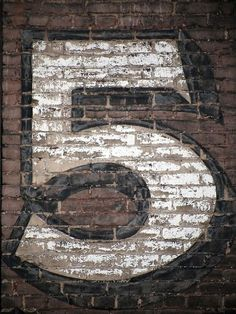 5 on bricks, black and white paint