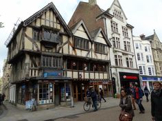 26–28 Cornmarket, on the corner of Ship Street in Oxford, is the surviving half of a timber-framed building completed around 1386 as the New Inn.  It belongs to Jesus College, Oxford and today houses a currency exchange.