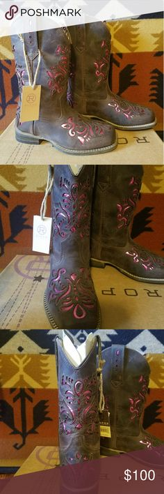 Cowgirl Boots BRAND NEW! Girls size 12 Roper brand cowgirl boots! Brown leather with beautiful metallic pink inlay. So cute! New with tags. Never worn. My parents bought these at the National Finals Rodeo in Las Vegas for my daughter but by the time she got them for here birthday she had a major growth spurt and they were too small for her. My mom paid $110. Asking $80. Very rare style. Perfect gift for your little cowgirl! My mom special ordered the right size for my daughter and they have…