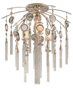 Shown in Topaz Leaf finish, Brazilian Rock Crystals crystal, Smoked Crystal Medallions glass, White Pearl Glass Shade shade and Nickel and Crystal Tassels accent