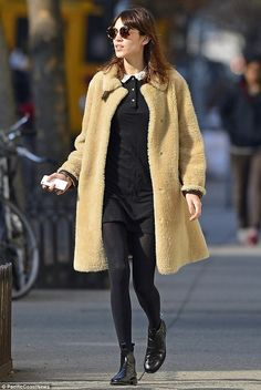 Vogue contributing editor Alexa Chung looked chic in a teddy bear coat worn over a little black dress featuring a white lace collar, black tights, black ankle boots and retro leopard print sunglasses. via dailymail.co.uk