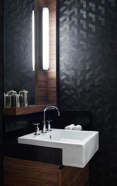 Black powder room with wood and white accents