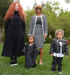 In Vogue: In 2014 she was slimmed down again and dressed up as Anna Wintour, complete with wig bob, oversized Chanel glasses and black-and-white Chanel suit; here she is seen with Joyce Bonnelli and their kids
