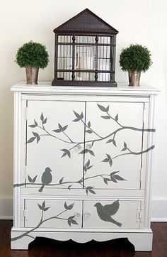 paint background in a solid color let dry overnight- copy a simple design on transparancy paper then use overhead projector to see design on furniture. use small flat brush to outline and color it in.